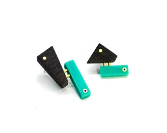 Mismatched wooden stud earrings with turquoise acrylic and brass details