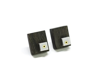 Wooden stud earrings with grey acrylic and brass details