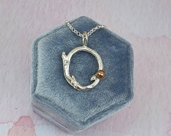 Silver twig eternal circle pendant with rose gold accent