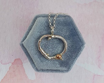 Silver twig and rose gold accent pendant