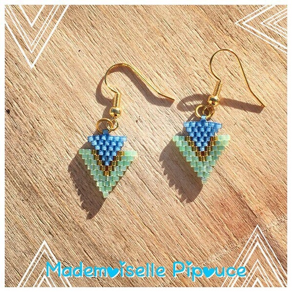 Metis woman blue and green earrings
