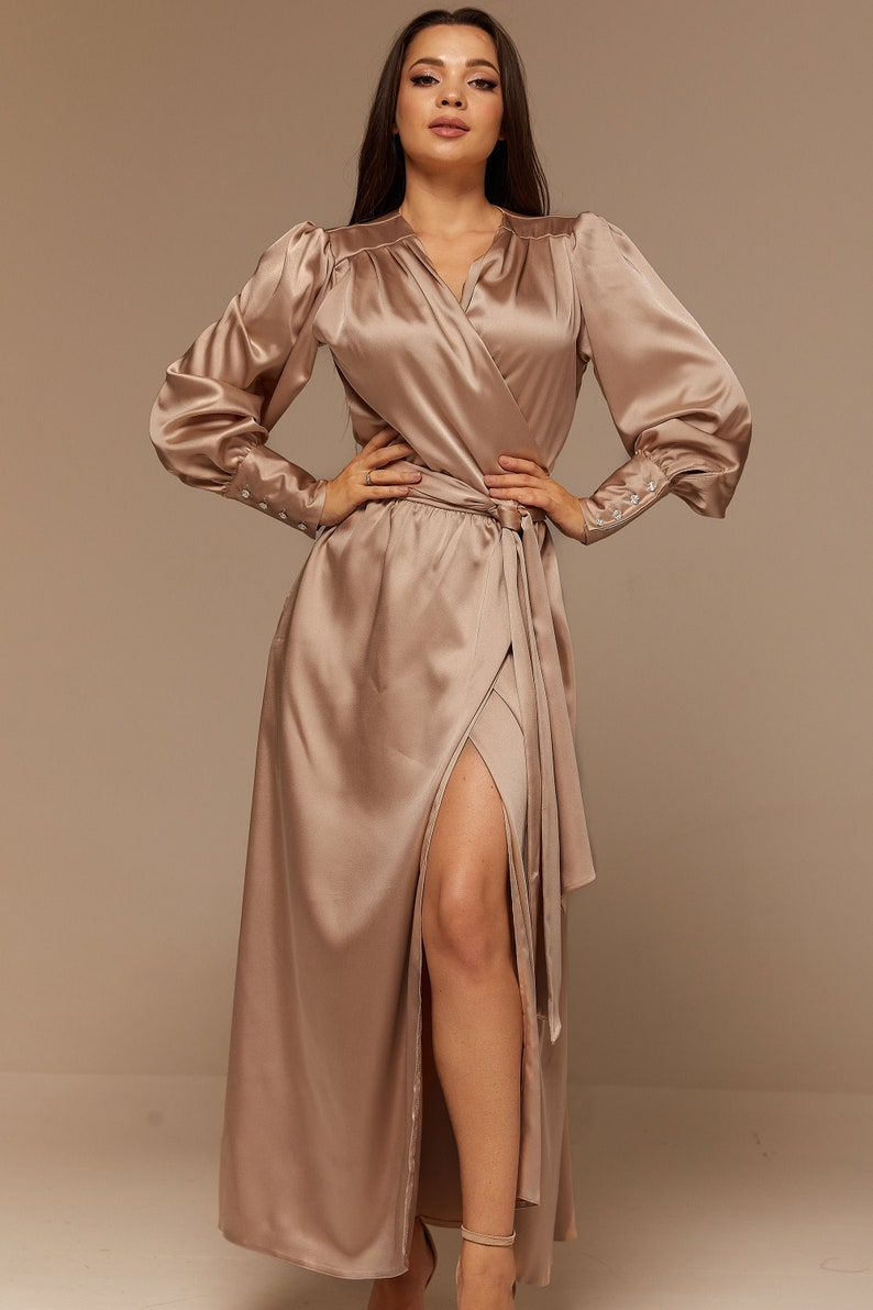 70s Disco Fashion: Disco Clothes, Outfits for Girls Beige Satin Maxi Full Wrap Dress with Long Sleeves Bridesmaid Dress $135.00 AT vintagedancer.com