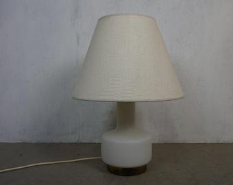 Elegant table lamp with illuminated light foot