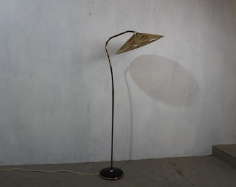 Extravagant floor lamp with fabric umbrella in typical fifties colours