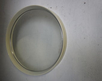 Round wall mirror from the 70s