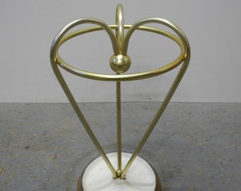Beautiful umbrella stand in gold shiny brass