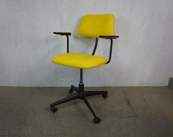 Stylish office swivel chair in bright yellow