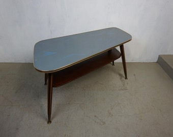 Beautiful kidney table with glass top in typical fifties pattern