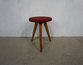 Minimalist tripod stool with cherry wood feet
