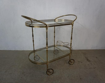 Elegant serving trolley with glass top of the 70s