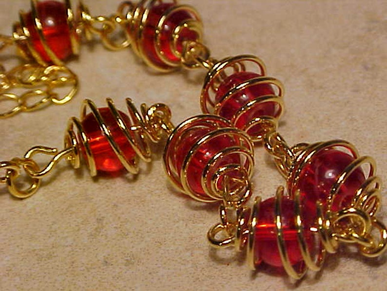 etsy Y-142 Stunning Unique Style 9K Gold Plated  8MM Caged RED Glass Beads Style Bracelet