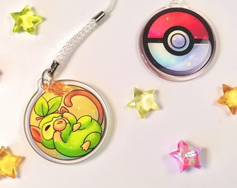 """Cute Grookey in a pokeball phonestrap, kawaii two-sided 1.5"""" acrylic charm keychain with glitter epoxy game creature 1st gen starter"""