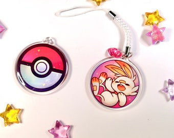 """Cute Scorbunny in a pokeball phonestrap, kawaii two-sided 1.5"""" acrylic charm keychain with glitter epoxy game creature 1st gen starter"""