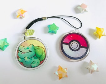 """Cute Bulbasaur in a pokeball phonestrap, kawaii two-sided 1.5"""" acrylic charm keychain with glitter epoxy game creature 1st gen starter"""