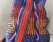 Bag: black stripes with orange, red and purple background
