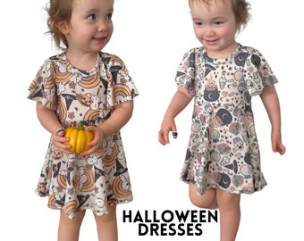 halloween dresses,  twirly halloween dress, potions and pumpkins dress, october dresses, flutter sleeve halloween girls dress, halloween