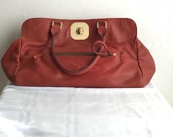 020d8cf845ec Vintage Longchamp rust leather bag with leopard lining