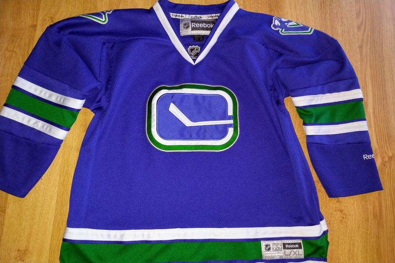 separation shoes c788d 224f3 Youth L/XL (women's s/m) Vancouver Canucks jersey