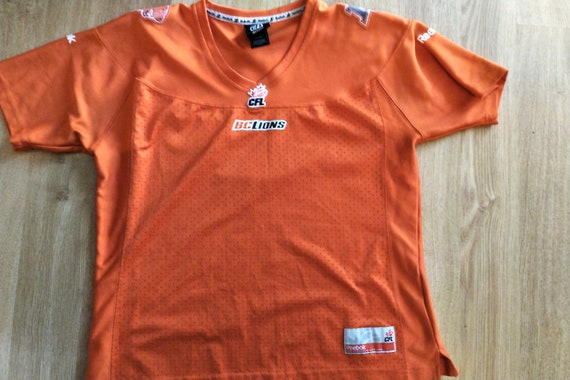 BC Lions jersey fits like a women/'s XS Youth S
