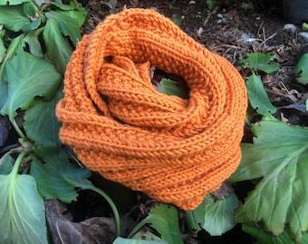 Hand-knitted orange wool snood