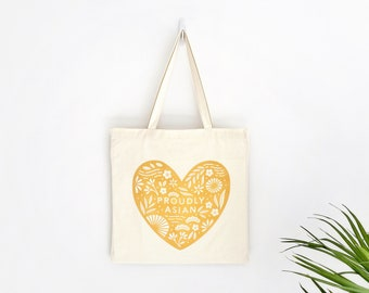 Proudly Asian White Eco-Friendly Tote Bag | Yellow and White | 100% Certified Organic Cotton | Portion of Profits Donated to Stop Asian Hate
