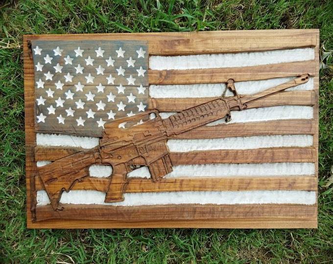 AR-15 Rifle Across American Flag