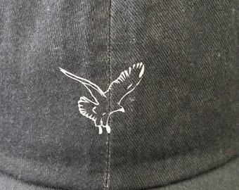 Custom Hat w/ white eagle symbol on grey colored cotton hat