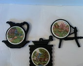 Set Of Three Vintage Currier Ives American Homestead Ceramic And Cast Iron Spinning Wheel, Teapot And Coffee Grinder Trivets