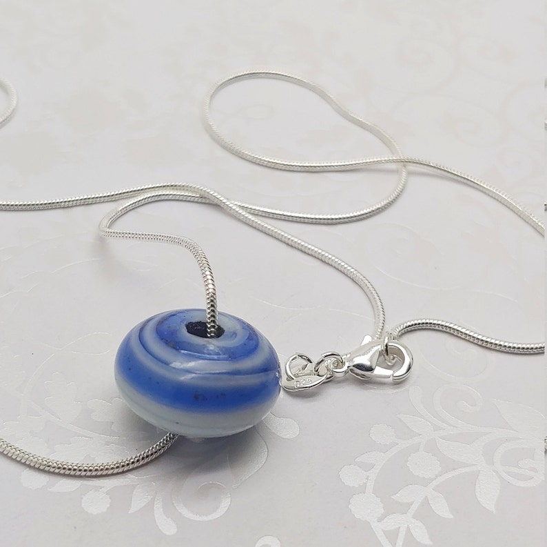 Bijoux by Rose Handcrafted Azure Swirl Ciambella Rose glass pendant on 20 inch silver plate snake chain