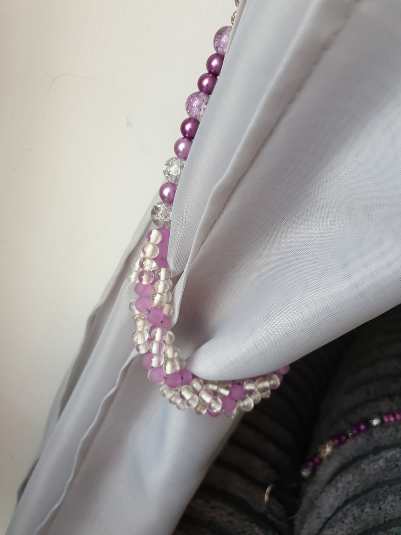 Purple and clear ornate curtain tie backs