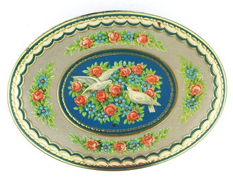 Oval tin with white doves and roses