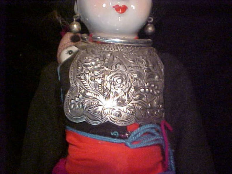 Traditional doll  from  Tibet or Nepal with local costume Ceramic