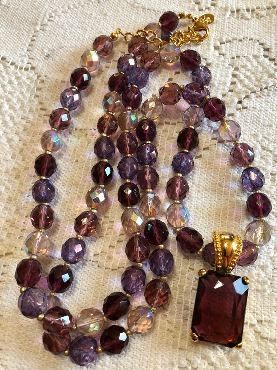 Joan rivers long  amethyst glass bead necklace