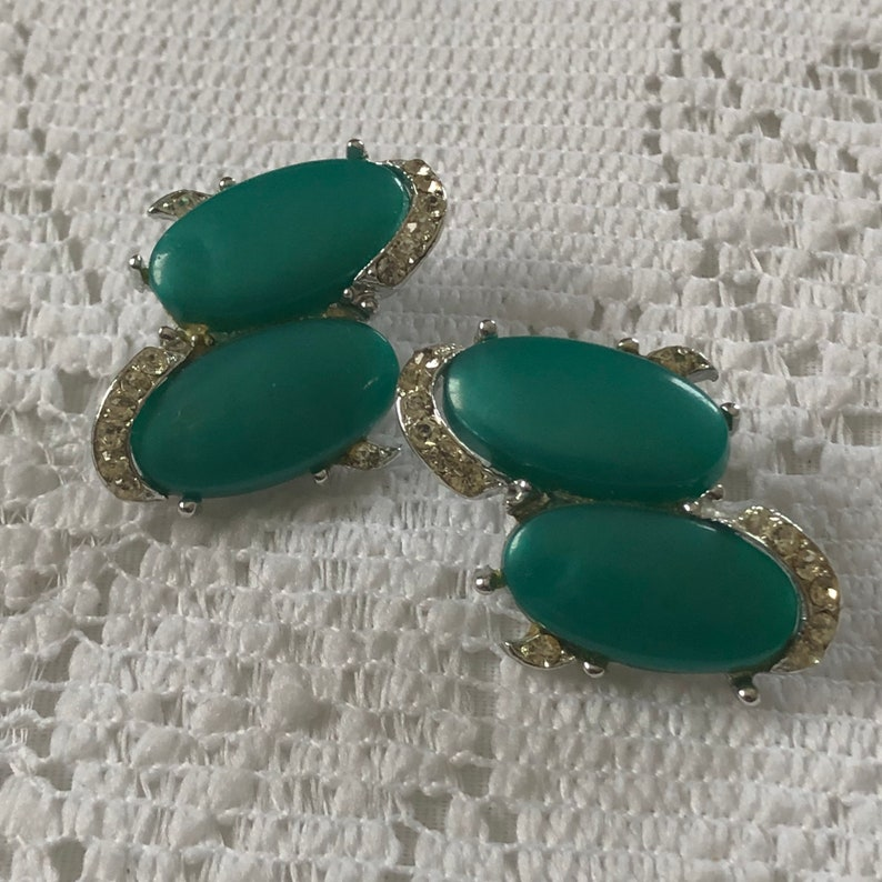 Vintage green thermoset  and rhinestone clip on earrings