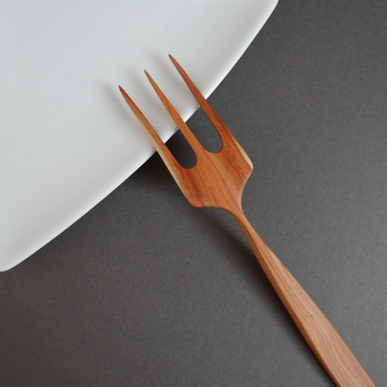 Plum wood hand carved cooking and serving fork