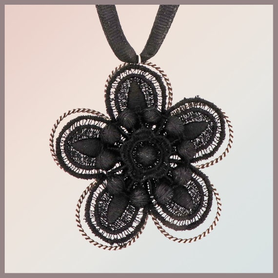Carmen black haute couture lace with sterling silver frame