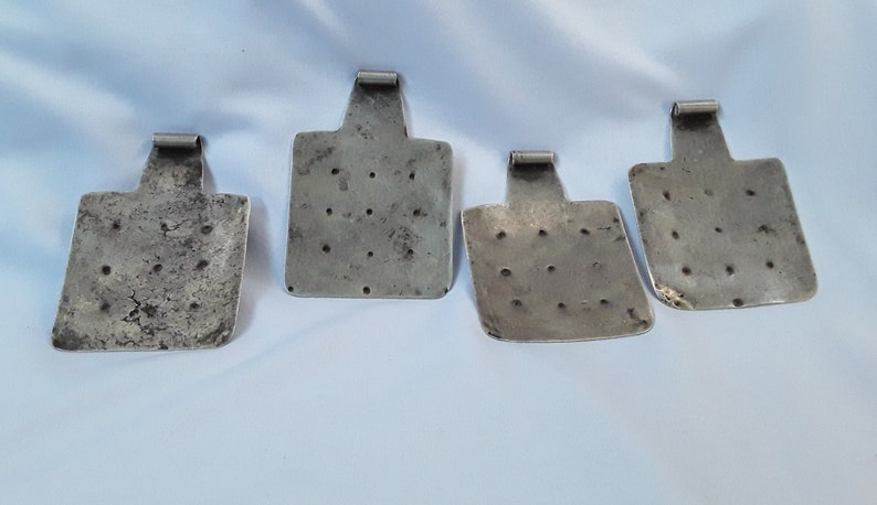 Set of four handmade Berber Silver and Niello Amulets