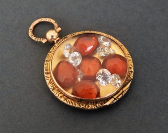 Antique Edwardian era shaker locket pendant in 9ct gold with hessionite garnets and white sapphires