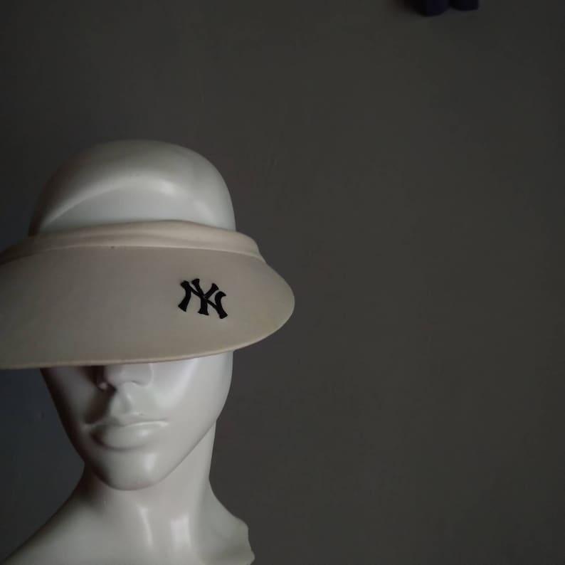 pre-owned set of 2 vintage sun visor