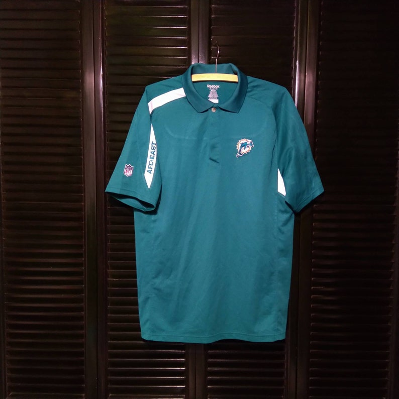 huge selection of e9628 b34e3 Old Vintage Reebok Miami Dolphins NFL Print Polo Shirt M