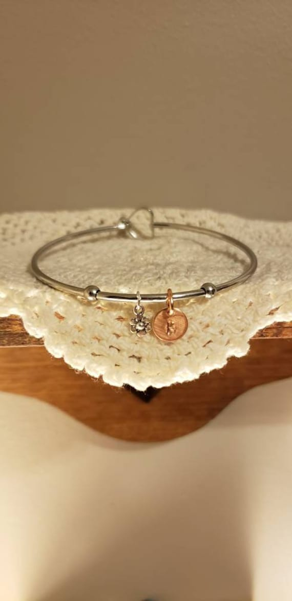 DiamondJewelryNY Eye Hook Bangle Bracelet with a Holy Communion Charm.