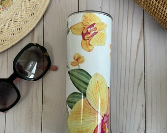 20 or 30 oz. stainless steel insulated tumbler beautifully decorated with yellow orchids all around. Keeps your drink cold or hot for hours!