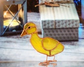 Yellow duckling in coloured glass. Valentine's Day gift for backyard décor. Suncatcher farmbird in stained glass. Holiday decorations