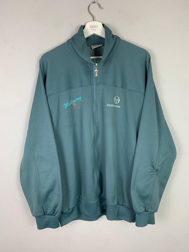 4f334c0d3d220 Men's Vintage Sergio Tachinni Softshell Tracksuit Jacket Top Blue UK Size  Large
