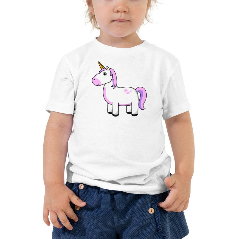 Cute Toddler Unicorn Cartoon Illustration Short Sleeve Tee image 0