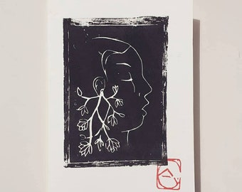 Linocut of a man in profile on A6+ card envelope