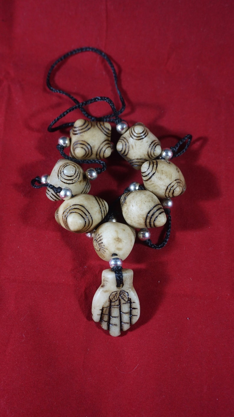 carved in stone Shaman/'s necklace chumpi and offering of hand