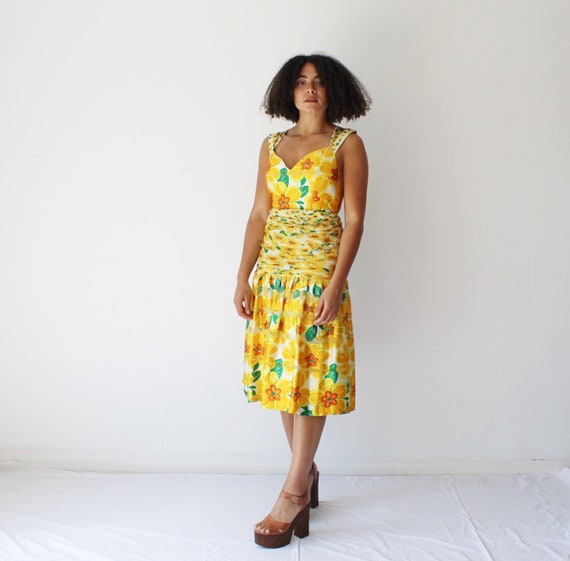 Vintage 1980s orange and yellow floral party dress
