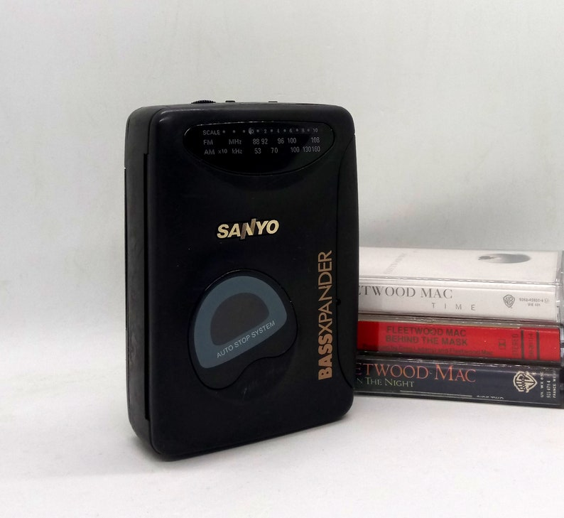 Working 90s SANYO walkman / stereo radio cassette player with FM/AM radio ,  bass expander and belt clip