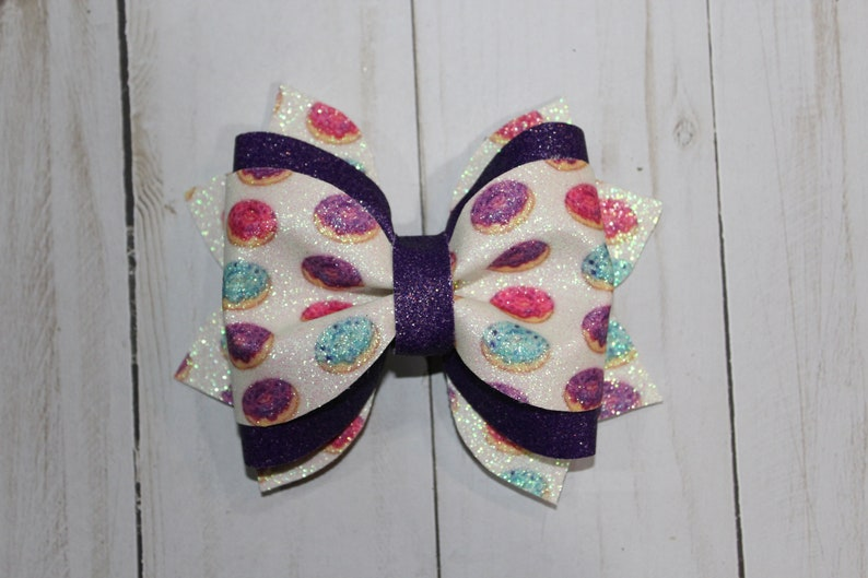 Donut hairbow. Purple glitter and purple donut pattern image 0